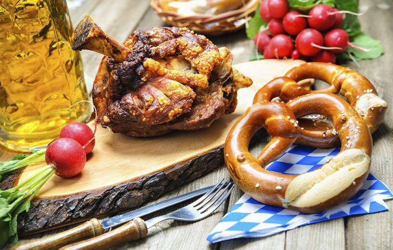 Roasted pork knuckle with pretzels and beer. Oktoberfest